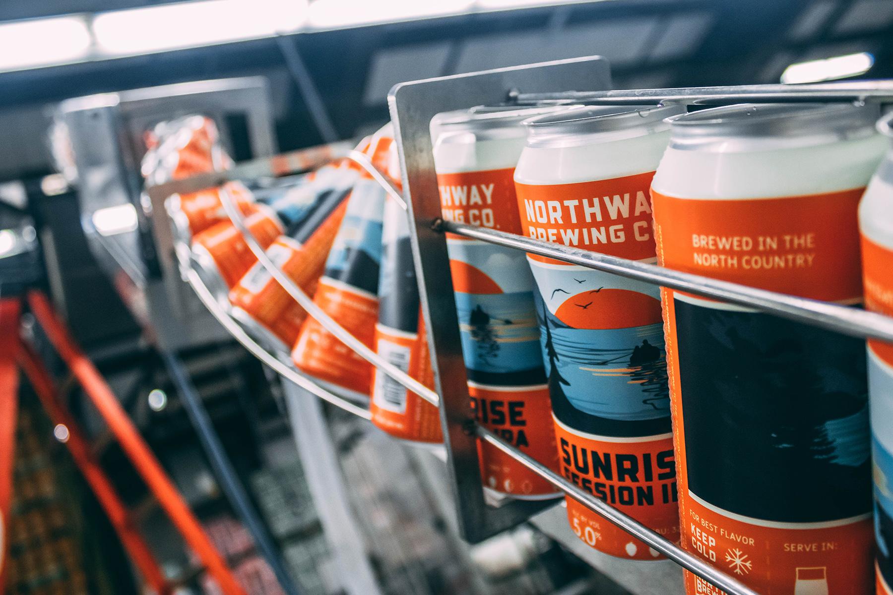 Packaging design beer cans on filling line