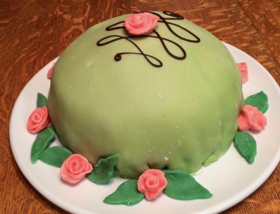 Prinsesstarta – Scandinavian Princess Cake;  a holiday classic of vanilla cakes filled with raspberry jam, pastry cream and whipped cream and enrobed in a marzipan fondant