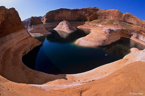 Kayaker on Lake Powell in Reflection Canyon, Glen Canyon National Recreation Area, Utah, copyright 2006 James Kay.