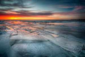 "Ice Sheets at Twilight, Nikon D800, Nikkor 14-24mm lens. ""Photographed on Lake St. Clair, Michigan - which is about a 25 minute drive from where I live.  I only photograph here in winter because of the dynamically changing conditions of the frozen lake.   I am always surprised at what the lake offers up to me in terms of compositional elements."""