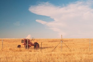 Old Tractor, Tall Grass Field and Edge of Thundercloud Near Oroville, California, copyright 2015 David Leland Hyde.