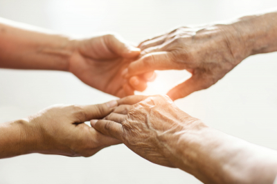 close up hands of helping hands elderly home care