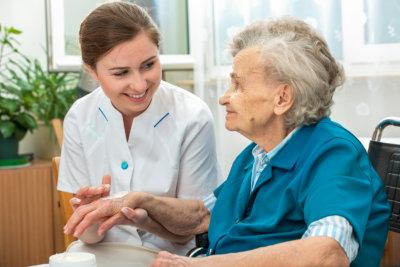 caregiver hold the hand of senior