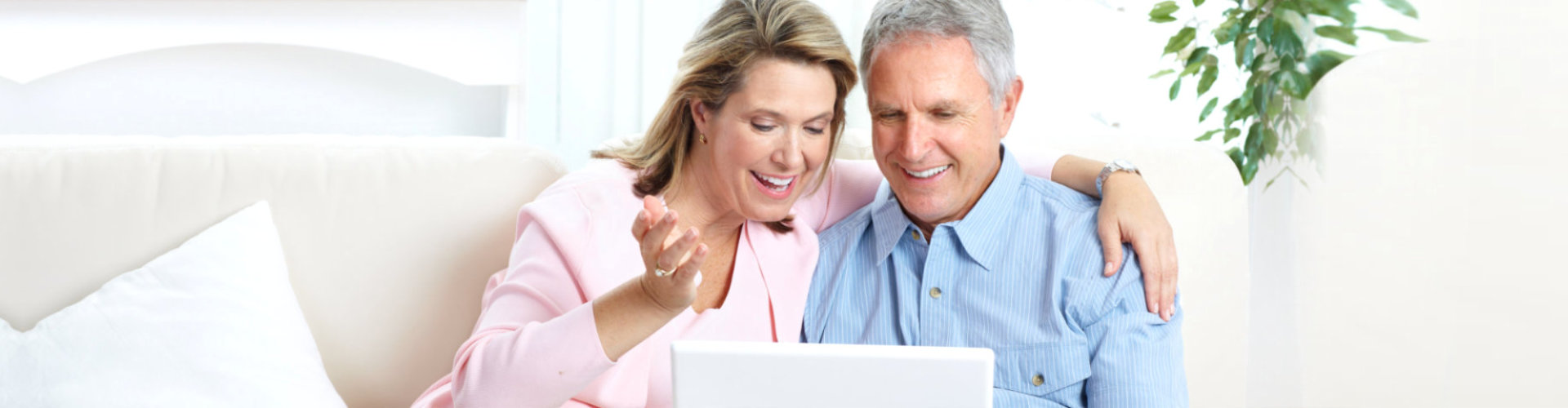 elder man with caregiver looking at the tablet