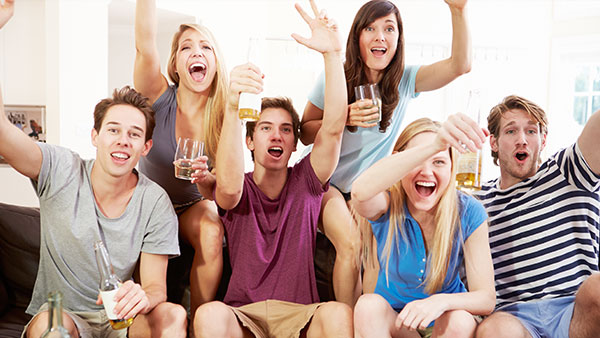 Five college students watching TV.
