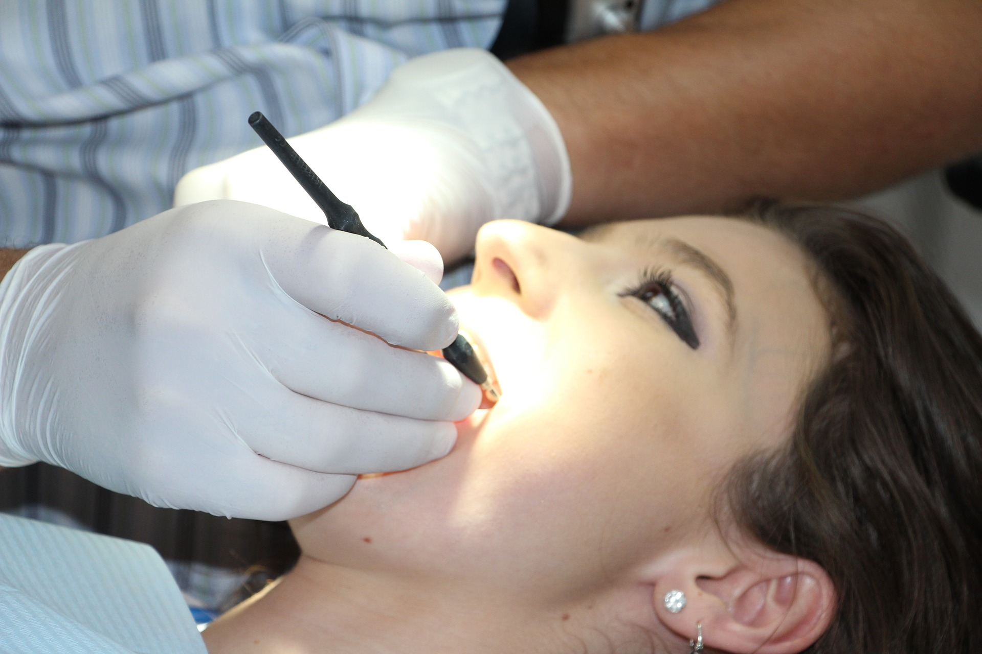 General check up It is a girl who is checking her oral health