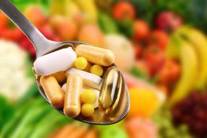 spoon with dietary supplements on fruits background supplementvitamindietarypillhealthtablethealthyspooneatorangemedicinedopingabuseaddictionaddictiveanalgesicbackgroundcapsulescarecolorfuldopedrugfishfruitharmfulhealinghealthcareillillnessindustryinsurancemedicationmetalnutritionoilpharmaceuticalpharmacyprescriptionsportsteeltreatmentvegetableswhiteyellowShow more