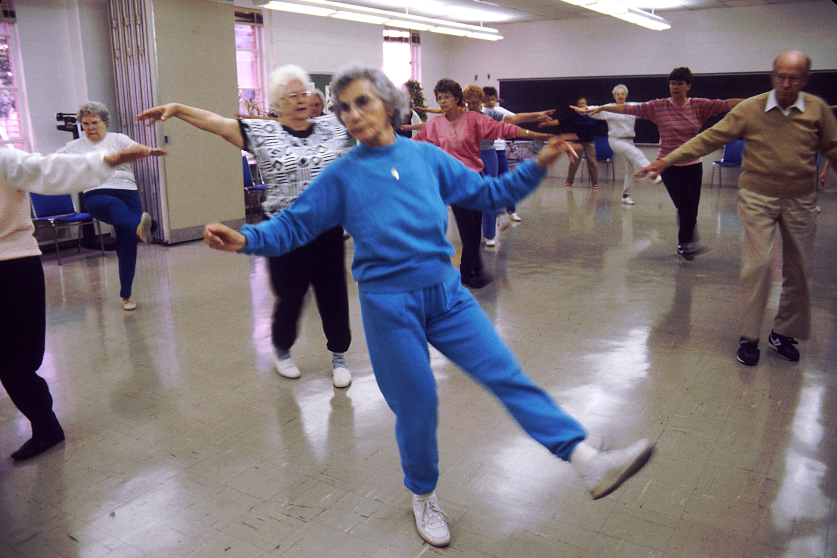 Seniors engaging in aerobics, not only to stay physical active, but mentally as well. Credit: Wikimedia Commons