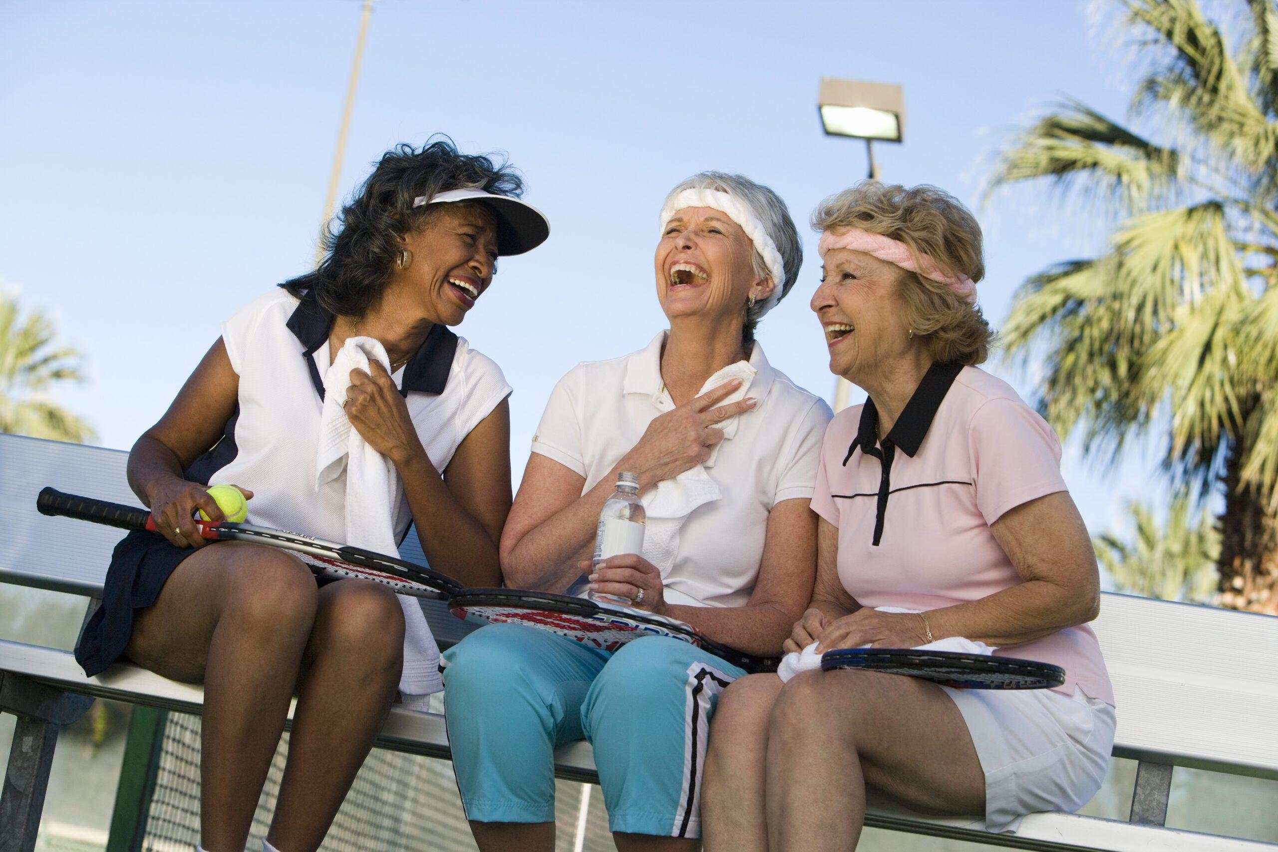 Three women on tennis court