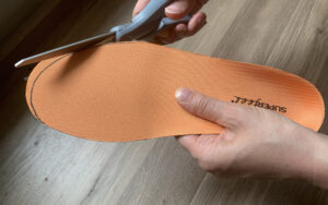 Step 3 of how to trim your insoles in 4 simple steps; Trim the insole along the line you have marked