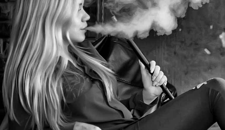 Beautiful glamorous girl smokes a hookah - Glendale Hookah Lounge