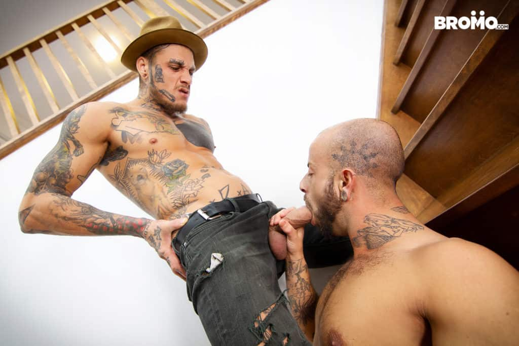 Slim, tattooed Bo Sinn was on his way downstairs when he found a bald-headed Edan Wolf sitting on the steps butt ass naked, and jerking off his long, hung cock. He couldn't just walk by the muscular hunk without sticking his massive, thick meat inside his mouth, and down his throat. Edan made sure to lube his dick up with enough saliva for him to be able to slide his eager bottom right onto it for a serious pounding.