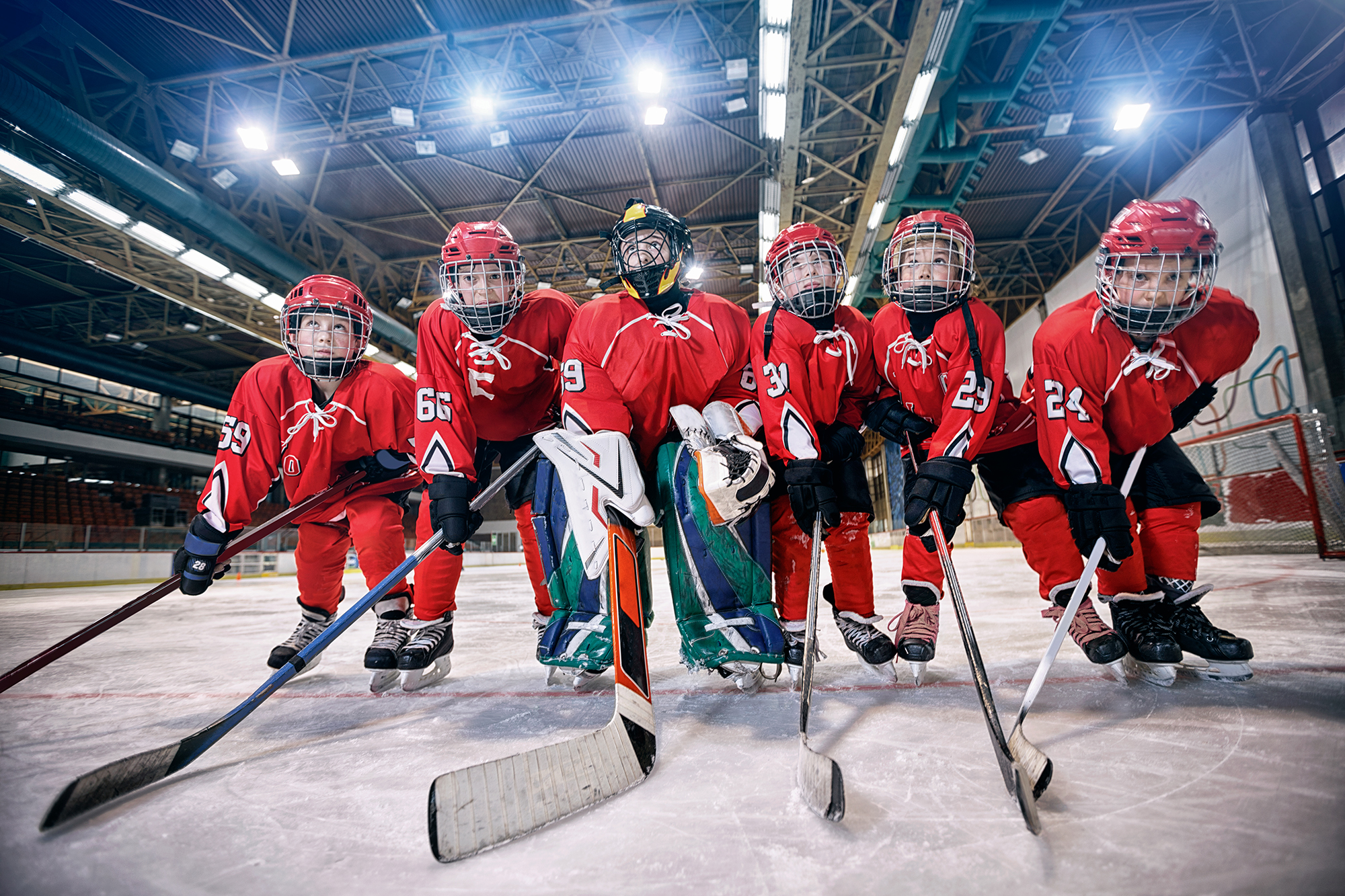 Youth hockey team - children play ice hockey