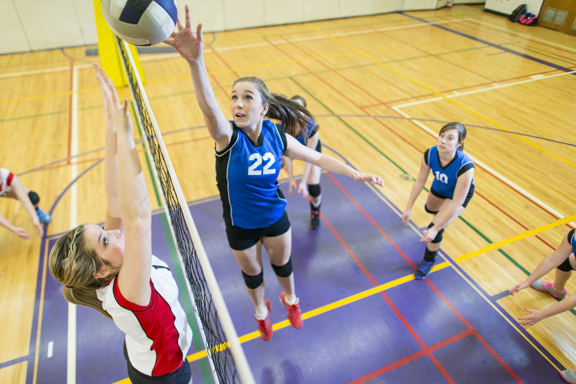 Girls highschool volleyball game.