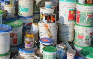 Waste buckets, hazardous waste products ready for proper disposal.