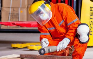 Metal worker in full safety gear, showing strengthened commitment to a safe workforce.