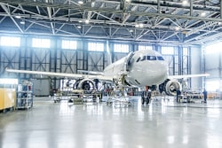 Airplane in a hangar. IATA International Aviation Transportation Association