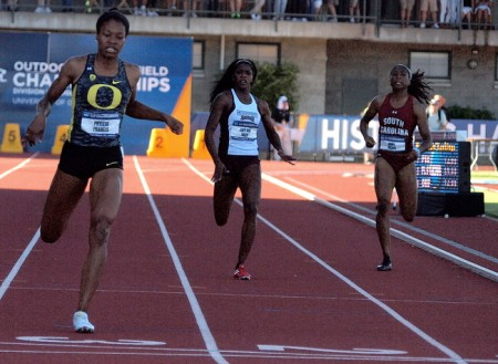 Phyllis Francis (L) crosses the finish line at Hayward Field in the 2013 NCAA Outdoor Track&Field Championships