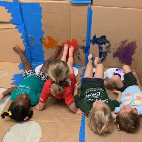 children-playing-with-cardboard