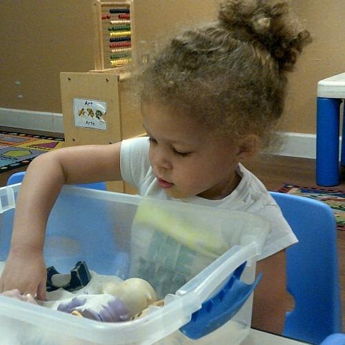 girl-playing-with-indoor-sandbox