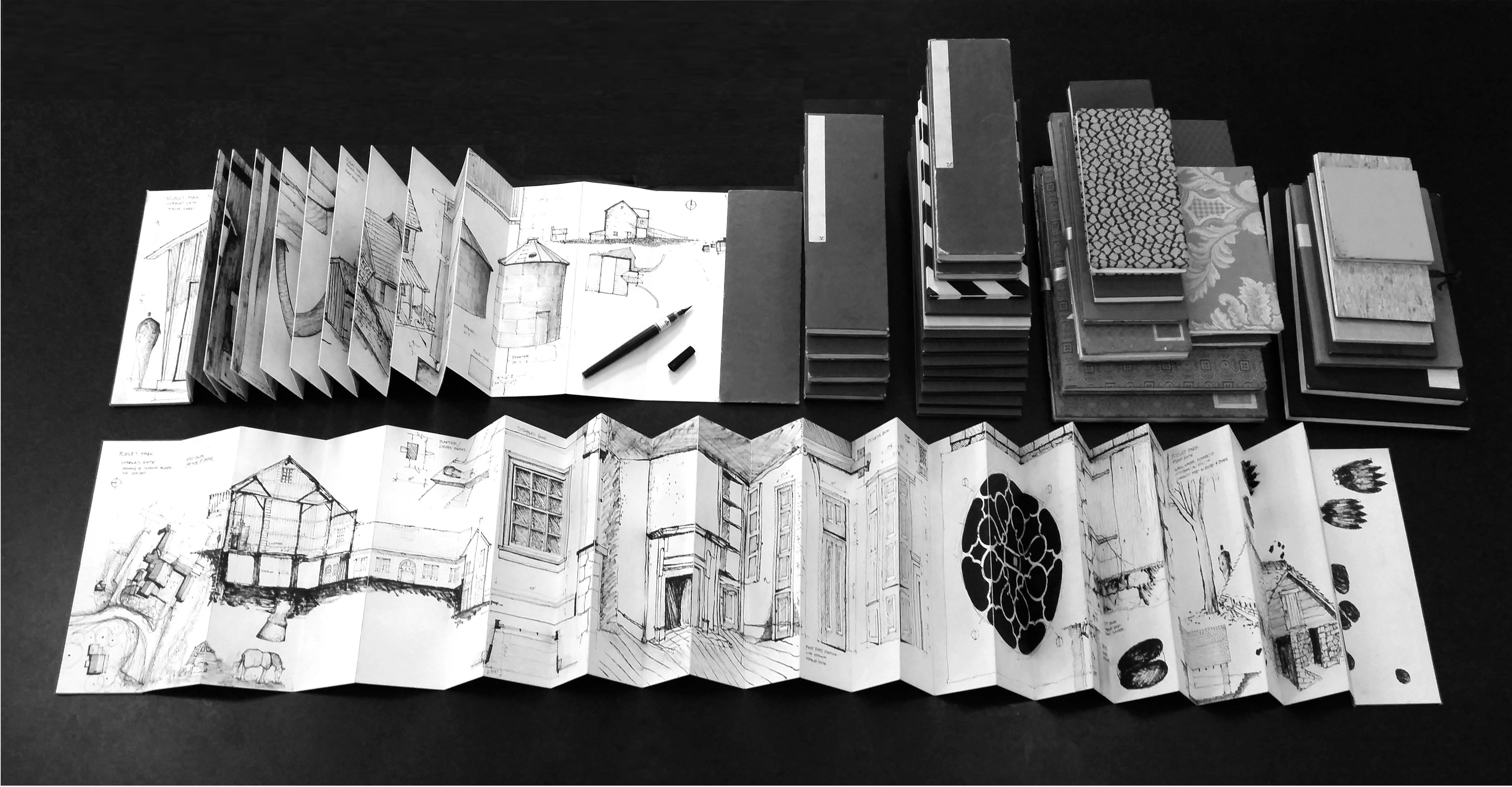 Sample sketchbooks unfolded with drawing brush pen