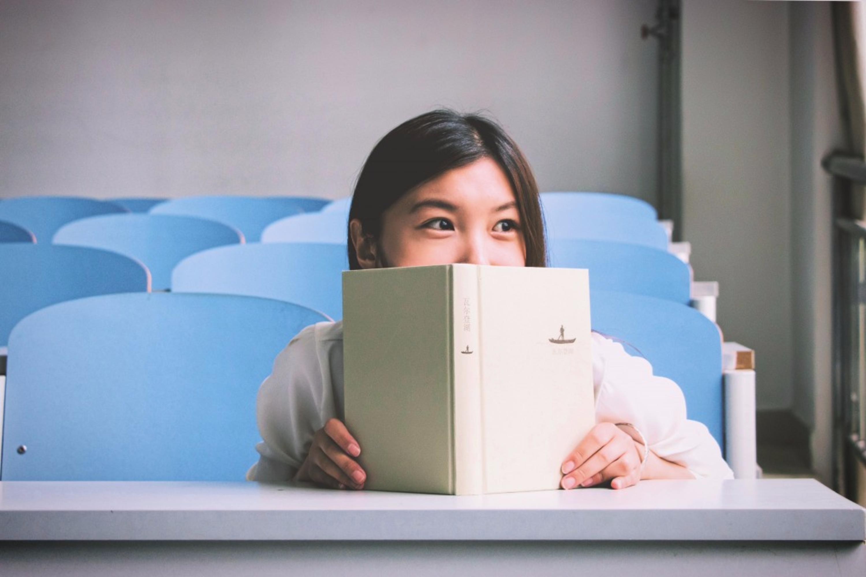 social anxiety symptoms girl hiding behind book