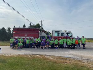 Team SSC in the 2020 Walk to End Alzheimer's stand in front of the Town of Sheboygan Fire truck