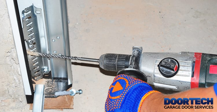 close-up of a Technician completing Garage Door Spring Replacement Arnold, Maryland