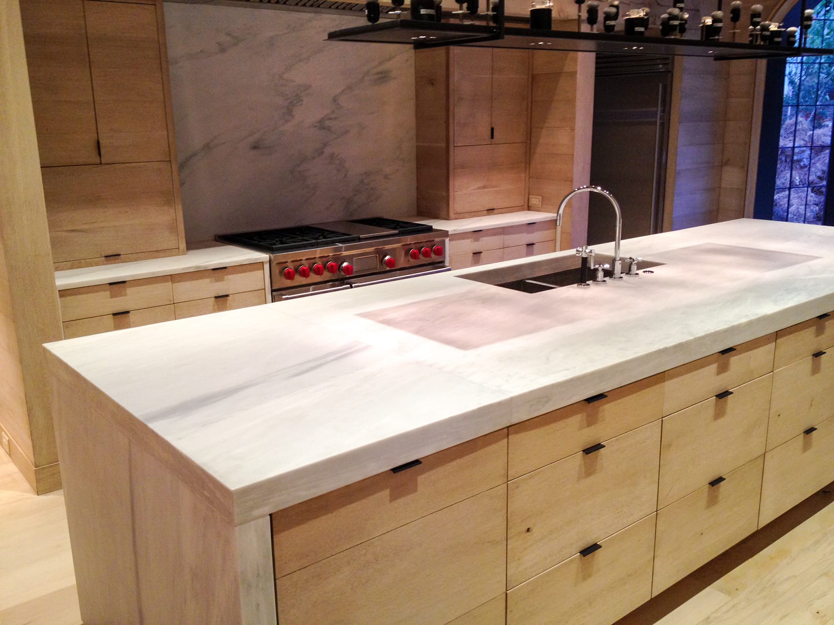All Wood Kitchen with stainless steel appliances close up view