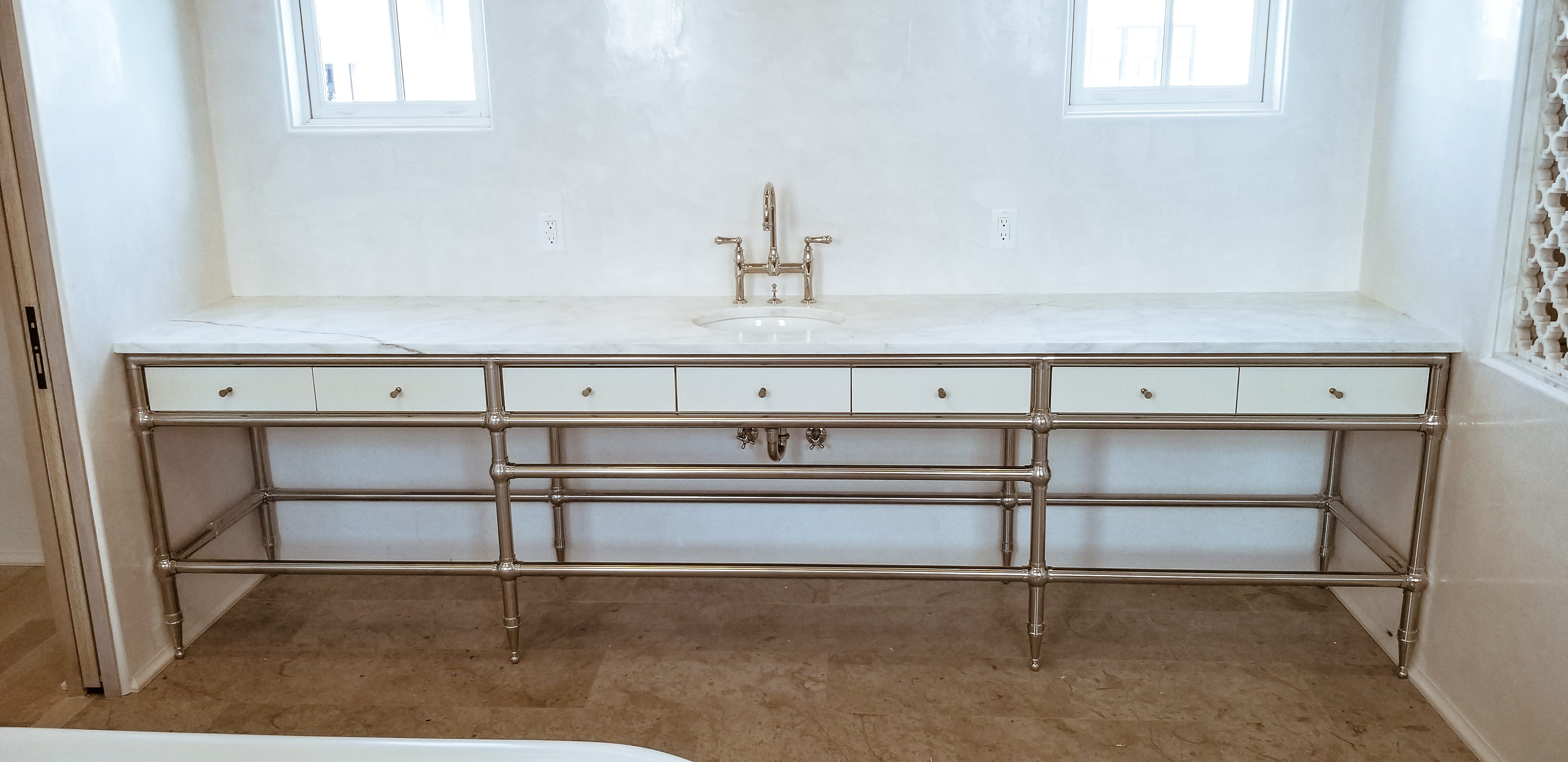 White vanity with metal rod detailing front view