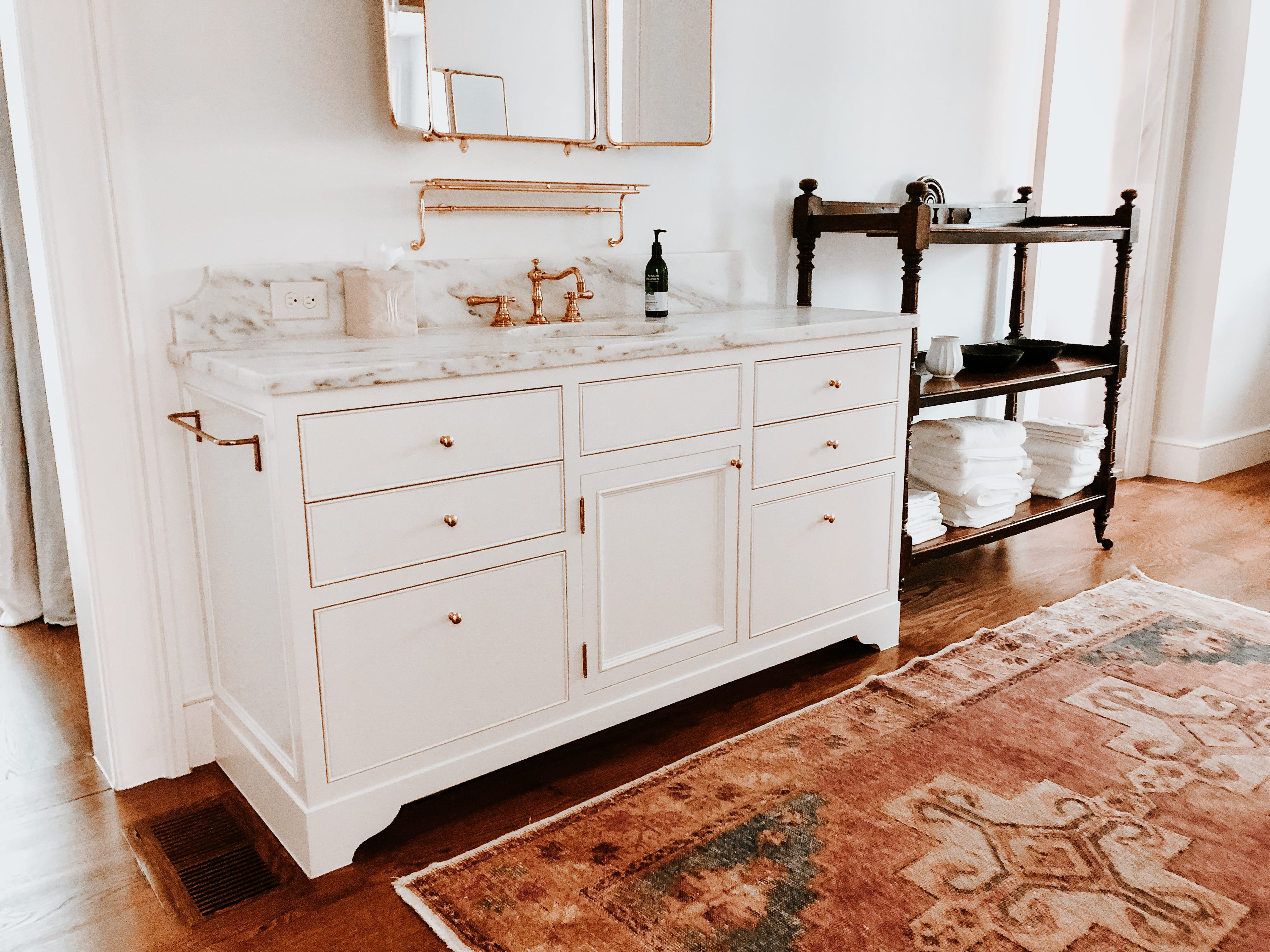 Timeless White Vanity with gold detailing and marble countertop side view