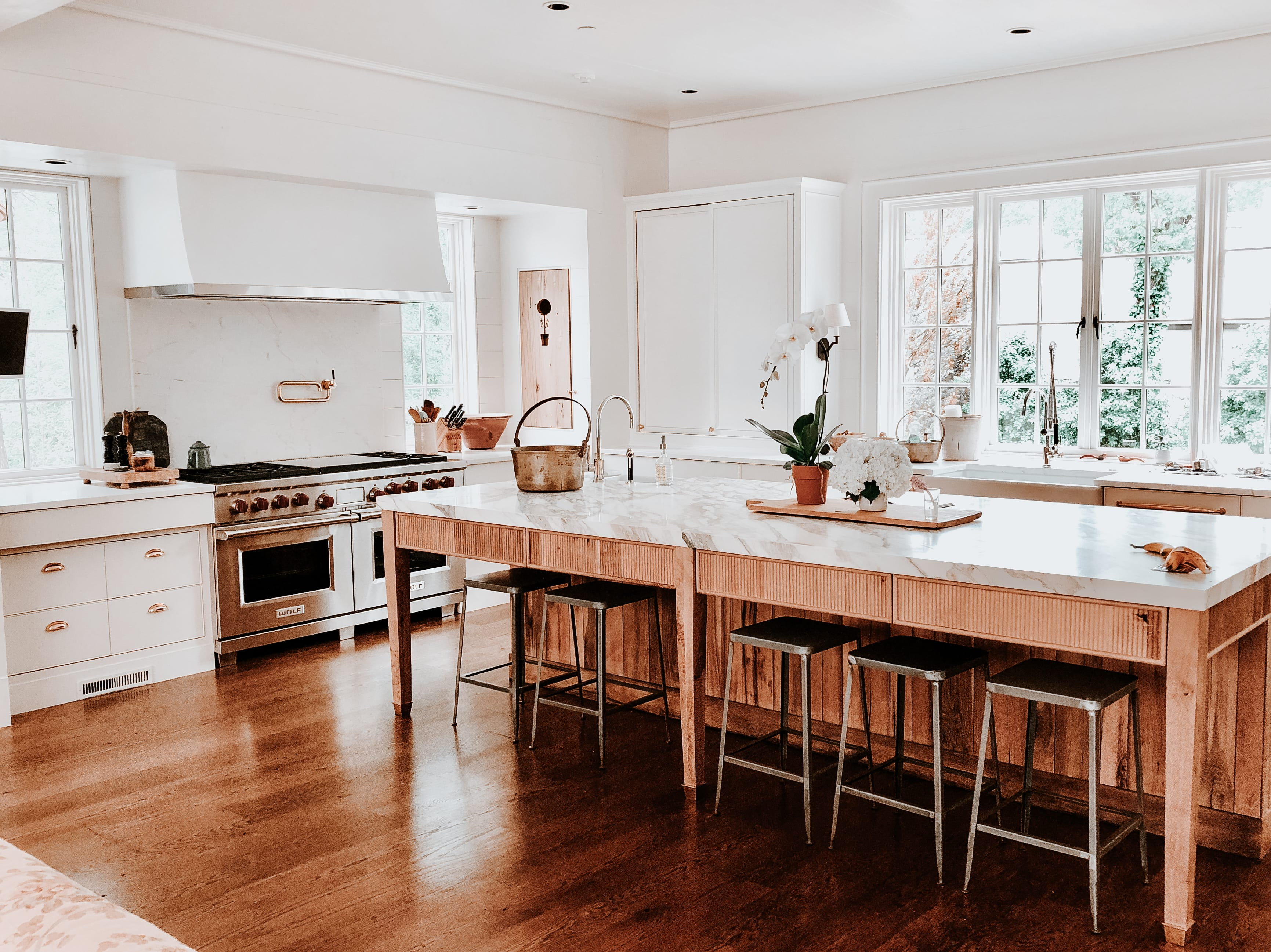Modern White kitchen with fluted wooden cabinets full view