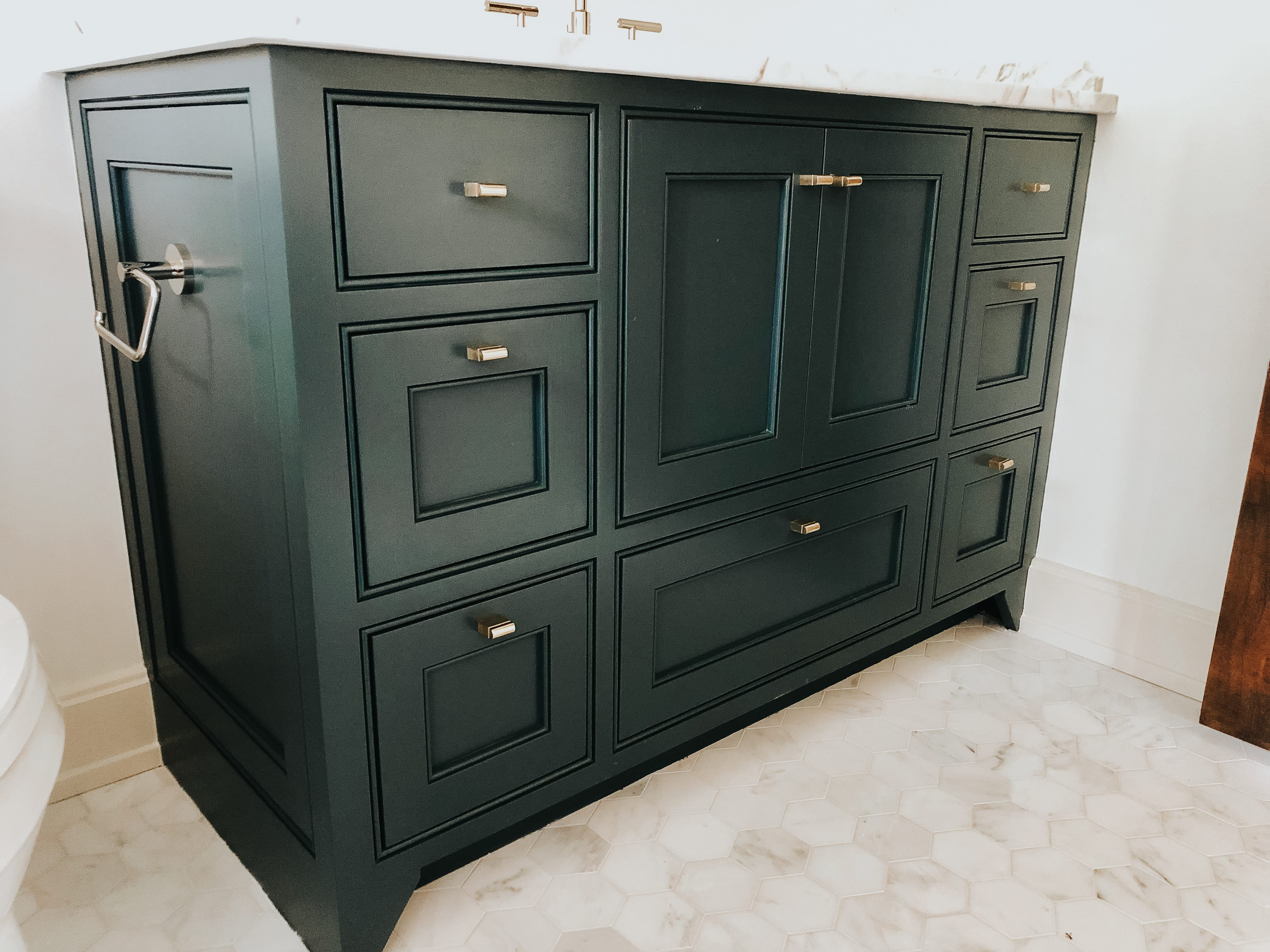 Simple Bathroom Vanity with black cabinets and marble top