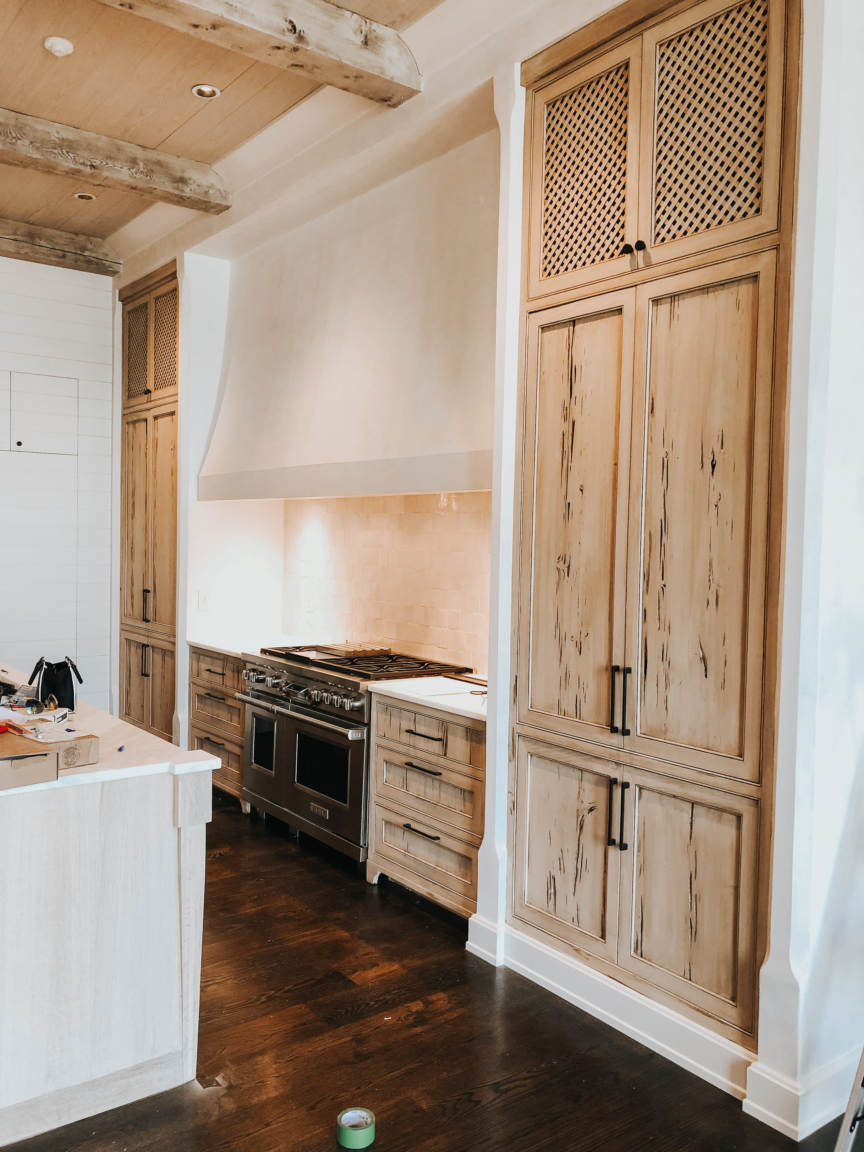 Beautiful Pecky cypress and oak kitchen we did designed by @adamsthom. Home built by @francisbryantconstruction