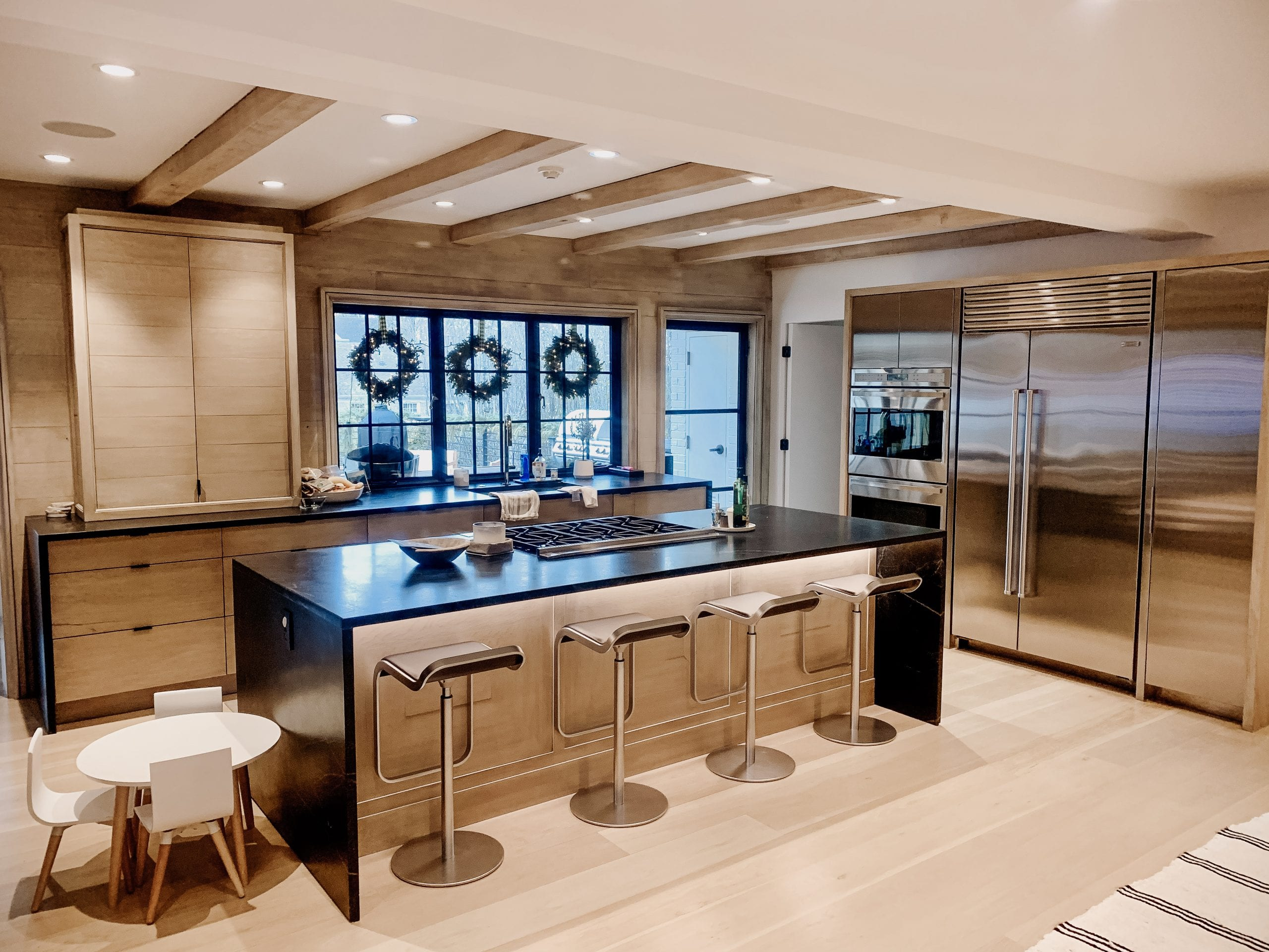 White oak and stainless steel cabinets