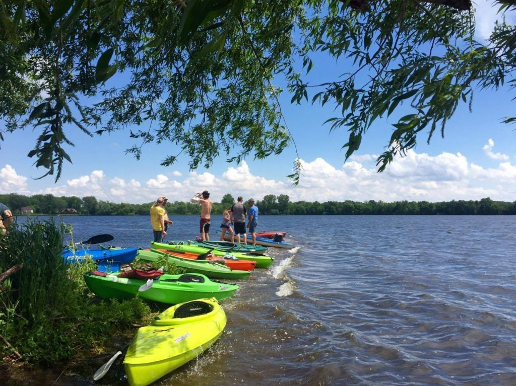 Kayakers enjoy a Faribault area lake
