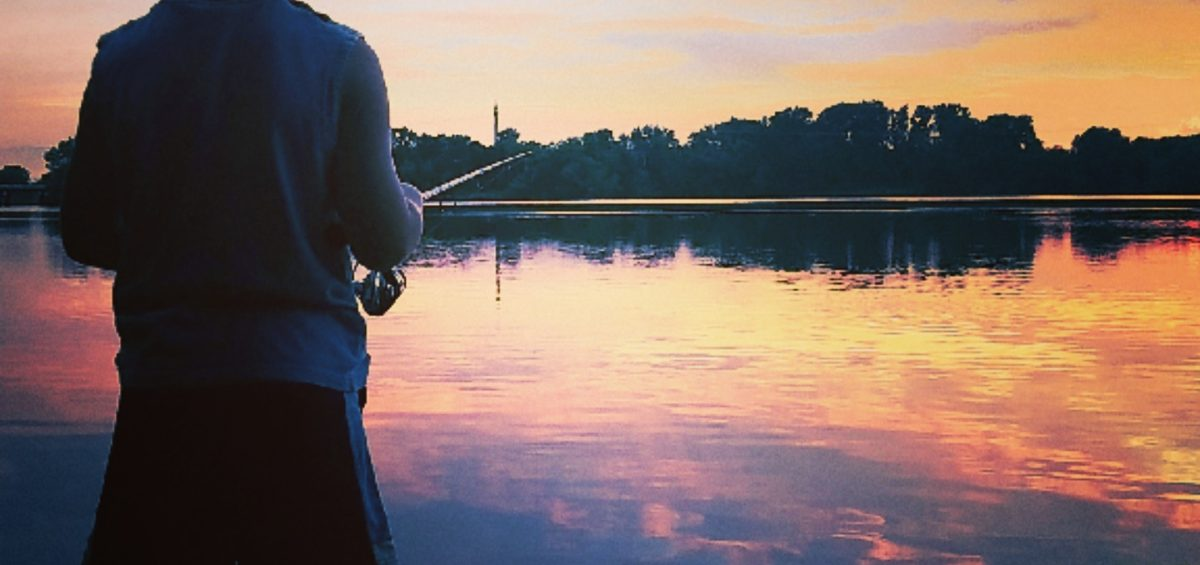 Boy Fishing at Sunset in Faribault via Aubrey O'Malley