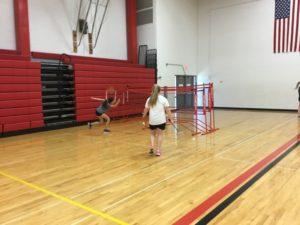 Students play badminton