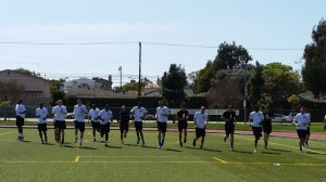 Collegiate athletes go through stretch-warm-up - Los Angeles, California (outdoor 2)
