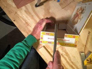 file the neck notch in the cigar box