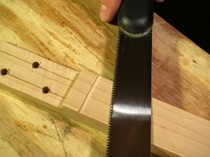 make shallow cuts at the nut line