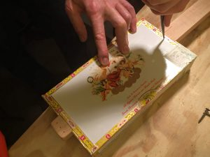 poke guide-holes in the box lid