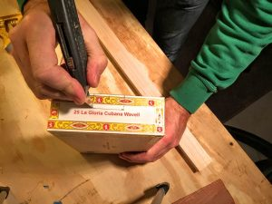score the cigar box with a razor knife