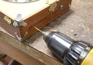 Pre-drilling strap button mounting holes is highly recommended.