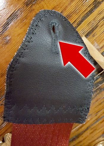 The slits in the ends of guitar straps are designed to go over strap buttons.