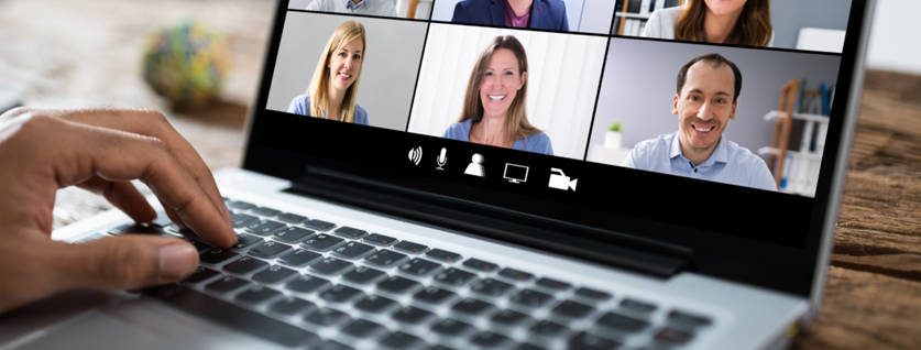 nine people on a video call displayed on a laptop screen
