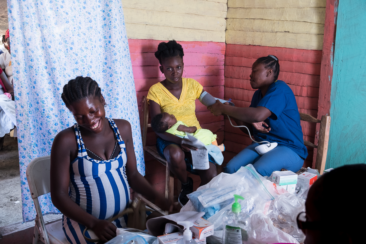 Women receive care at a Mobile Prenatal Clinic in rural Haiti by Midwives For Haiti. Photo by Cheryl Hanna-Truscott