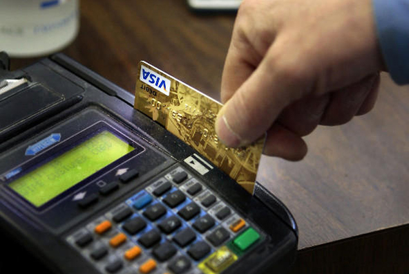 Banks, Retailers Fight on over Debit Card Interchange Fees