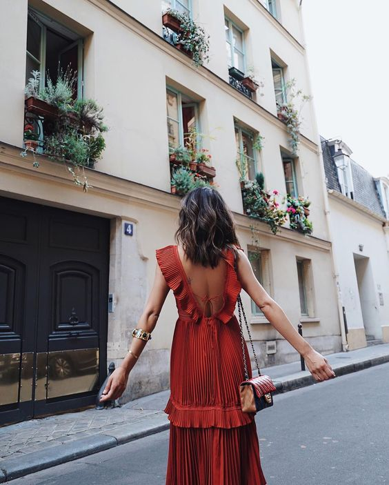 Red ruffles on red dress perfect for travel | Girlfriend is Better