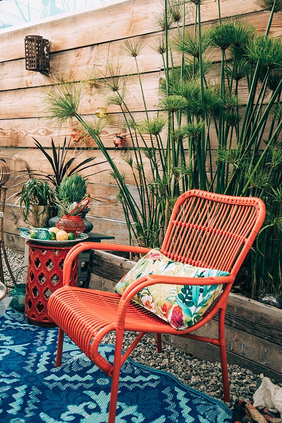 Bamboo chair in bright orange on summer patio | Girlfriend is Better